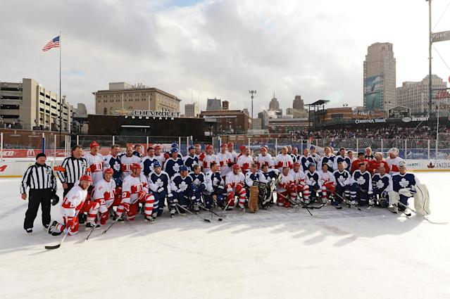 DETROIT, MI - DECEMBER 31: Alumni of the both the Toronto Maple Leafs and the Detroit Red Wings pose together for a photo on the ice after the end of the first game of the 2013 Hockeytown Winter Festival Alumni Showdown on December 31, 2013 at Comerica Park in Detroit, Michigan. (Photo by Jamie Sabau/Getty Images)