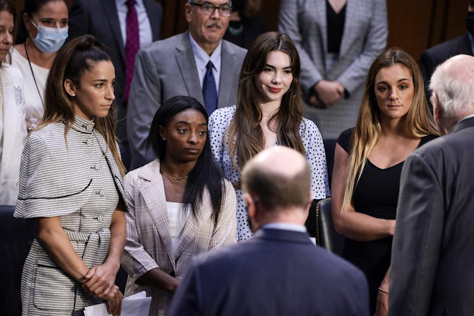 From left, Aly Raisman, Simone Biles, McKayla Maroney and NCAA and Maggie Nichols appear before members of the Senate Judiciary Committee on Tuesday to discuss the FBI's handling of the Larry Nassar investigation.