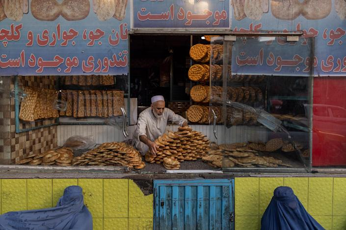 """Two women beg for alms outside a Kabul bakery on Sept. 13.<span class=""""copyright"""">Victor J. Blue—The New York Times/Redux</span>"""
