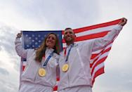 <p>USA's Amber English (L) and USA's Vincent Hancock pose with their gold medals and national flag on the podium after in the skeet finals during the Tokyo 2020 Olympic Games at the Asaka Shooting Range in the Nerima district of Tokyo on July 26, 2021. (Photo by Tauseef MUSTAFA / AFP) (Photo by TAUSEEF MUSTAFA/AFP via Getty Images)</p>