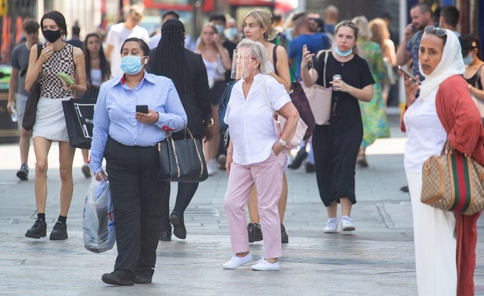 People wearing face masks in central London, after the final coronavirus legal restrictions were lifted in England (Dominic Lipinski/PA) (PA Wire)