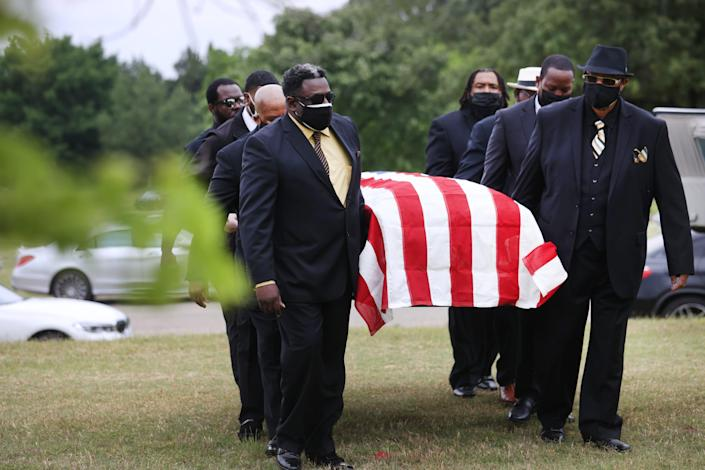 Pallbearers carry the coffin of Ivory Beck Sr. during funeral services at Memorial Park South Woods on Saturday May 29, 2021.