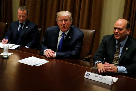 U.S. President Donald Trump meets with a bipartisan group of members of Congress, including U.S. Representative Josh Gottheimer (D-NJ) (L) and Representative Tom Reed (R-NY) (R), at the White House in Washington, U.S. September 13, 2017.  REUTERS/Jonathan Ernst