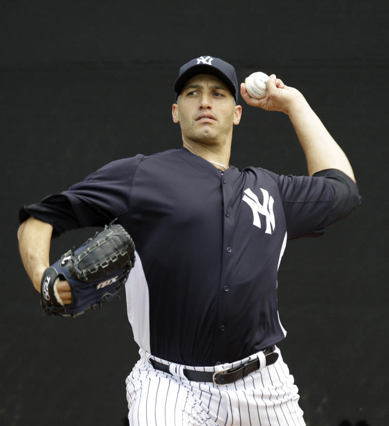 Andy Pettitte, who came out of retirement on a minor league contract to pitch for his former team, throws in the bullpen after arriving at the Yankees spring training facility at Steinbrenner Field in Tampa, Fla., Tuesday, March 20, 2012.  (AP Photo/Kathy Willens)