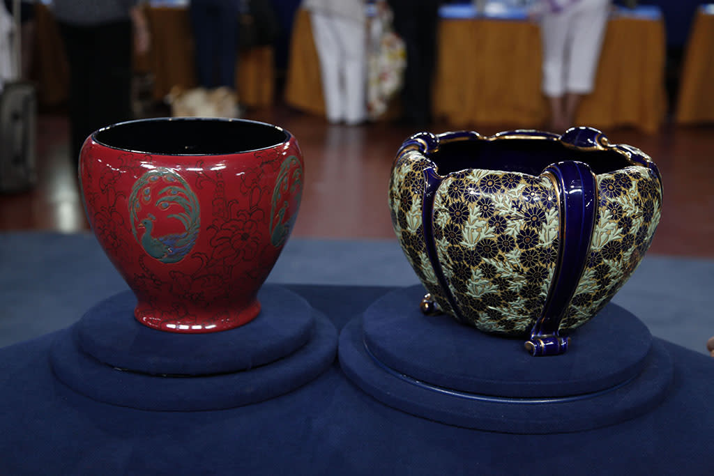 Rookwood and French pottery jardinieres. Valued at $10,100-$15,150.