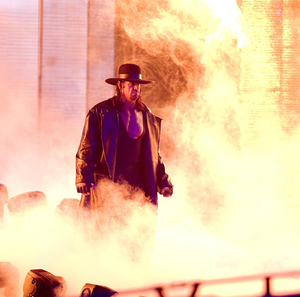 The Undertaker makes his way to the ring in smoke.
