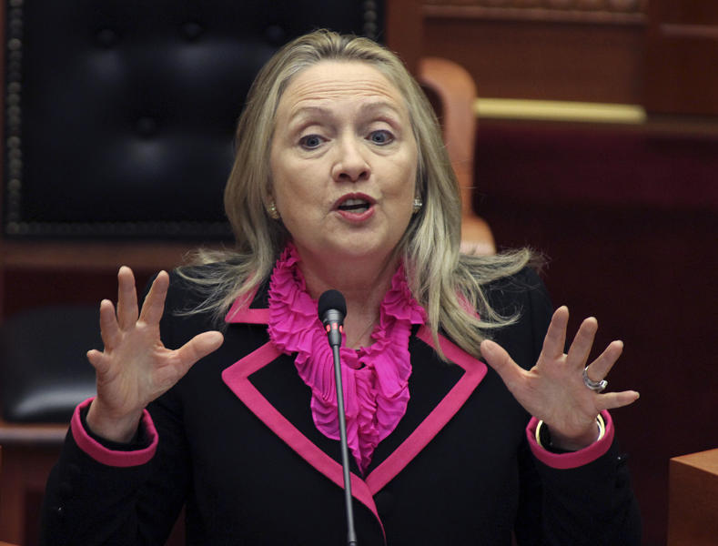 FILE - In this Thursday, Nov. 1, 2012 file photo, Secretary of State Hillary Rodham Clinton makes a speech at the Parliament in the capital Tirana, Albania. Alarmed that rebel militias could be profiting from a sharp increase in the poaching of elephants and rhinos, the U.S. plans to step up efforts to build a global coalition to combat the illegal wildlife trade, Secretary of State Hillary Rodham Clinton said Thursday, Nov. 8, 2012 in Washington. (AP Photo/Hektor Pustina, File)