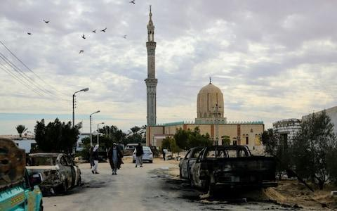 Wreckages of cars are seen after the Egypt Sinai mosque bombing - Credit: Stringer/Anadolu Agency/Getty Images