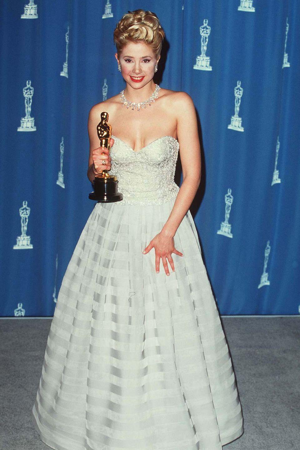 <p>As if Mira Sorvino knew she would be the winner of the night, the actress aptly dressed as a princess for her big Academy win for <em>The Mighty Aphrodite. </em></p>