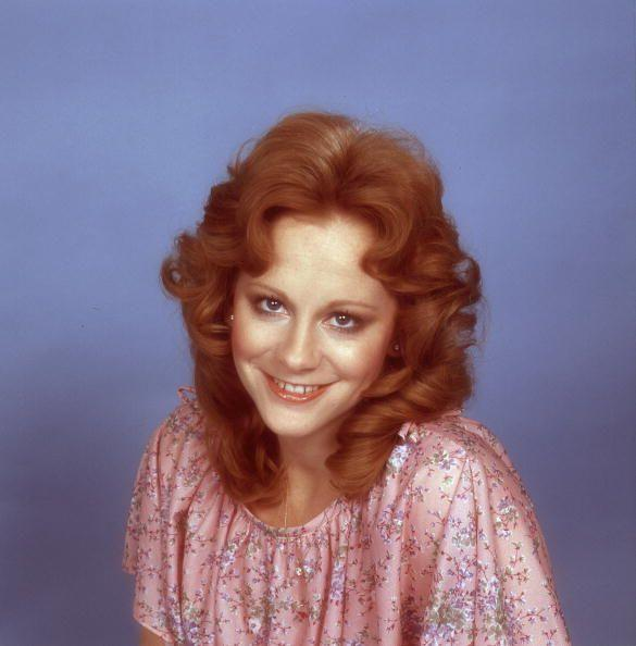 <p>In 1976, Reba looked every bit the doe-eyed bombshell during a portrait session in Nashville, Tennessee.</p>