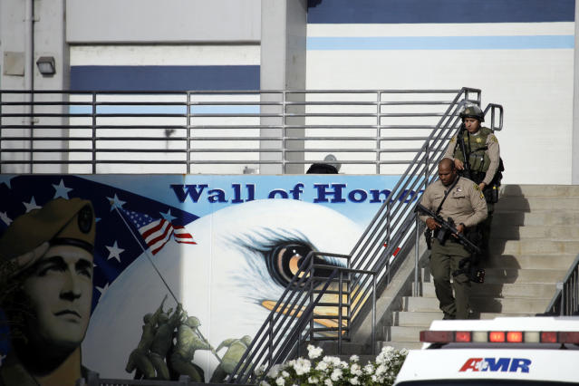 Law enforcement personnel walk with their weapons drawn outside of Saugus High School after reports of a shooting on Nov. 14, 2019, in Santa Clarita, Calif. Los Angeles County Sheriff Alex Villanueva tweeted that the suspect was in custody and was being treated at a hospital. He said the suspect was a student but gave no further information. (Photo: Marcio Jose Sanchez/AP)