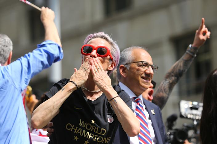 Megan Rapinoe acknowledges fans who turned out for the U.S. women's soccer team is celebrated with a parade along the Canyon of Heroes, Wednesday, July 10, 2019, in New York. (Photo: Gordon Donovan/Yahoo News)
