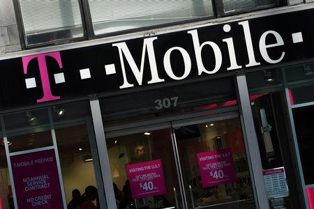 FILE PHOTO: A T-Mobile store is pictured in the Manhattan borough of New York, New York, U.S., May 20, 2019. REUTERS/Carlo Allegri/File Photo
