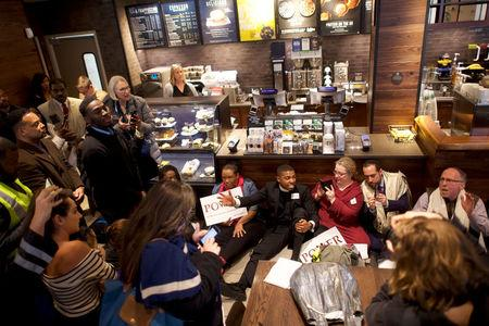 Interfaith clergy leaders stage a sit-in at the Center City Starbucks, where two black men were arrested, in Philadelphia, Pennsylvania U.S. April 16, 2018.  REUTERS/Mark Makela