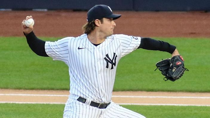 Apr 6, 2021; Bronx, New York, USA; New York Yankees pitcher Gerrit Cole (45) pitches in the first inning against the Baltimore Orioles at Yankee Stadium.