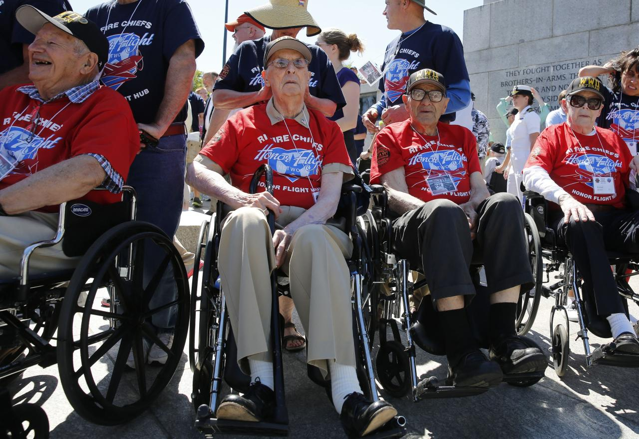 World War II veterans from Rhode Island sit during a ceremony at the National World War II Memorial marking the 70th anniversary of the D-Day invasion of Europe on June 6, 1944, while in Washington, June 6, 2014. The veterans arrived on the Rhode Island Association of Fire Chiefs Foundation honor flight earlier today. REUTERS/Larry Downing (UNITED STATES - Tags: MILITARY CONFLICT ANNIVERSARY)