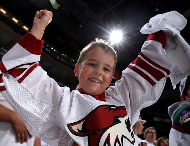 GLENDALE, AZ - MAY 22: Phoenix Coyotes fan Ethan Bryant of Phoenix cheers on the Coyotes before Game Five of the Western Conference Final during the 2012 NHL Stanley Cup Playoffs against the Los Angeles Kings at Jobing.com Arena on May 22, 2012 in Phoenix, Arizona. (Photo by Christian Petersen/Getty Images)
