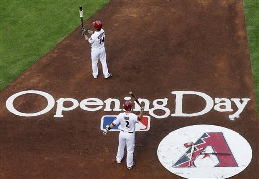 Arizona Diamondbacks' Aaron Hill (2) and Ryan Roberts (14) stand on deck in the second inning of an opening day baseball game against the San Francisco Giants, Friday, April 6, 2012, in Phoenix. (AP Photo/Matt York)