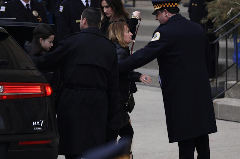 The wife of slain Chicago police Cmdr. Paul Bauer, Erin, right, and the Bauer's 13-year-old daughter, Grace, left, arrive to Nativity of Our Lord Catholic Church in Chicago on Saturday, Feb. 17, 2017. Cmdr. Bauer was shot to death while confronting a suspect earlier in the week. (Abel Uribe/Chicago Tribune/TNS via Getty Images)