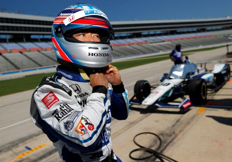 Former Indianapolis 500 winner Takuma Sato, shown preparing for practice, crashed on his warm-up lap and missed the race (AFP Photo/TOM PENNINGTON)