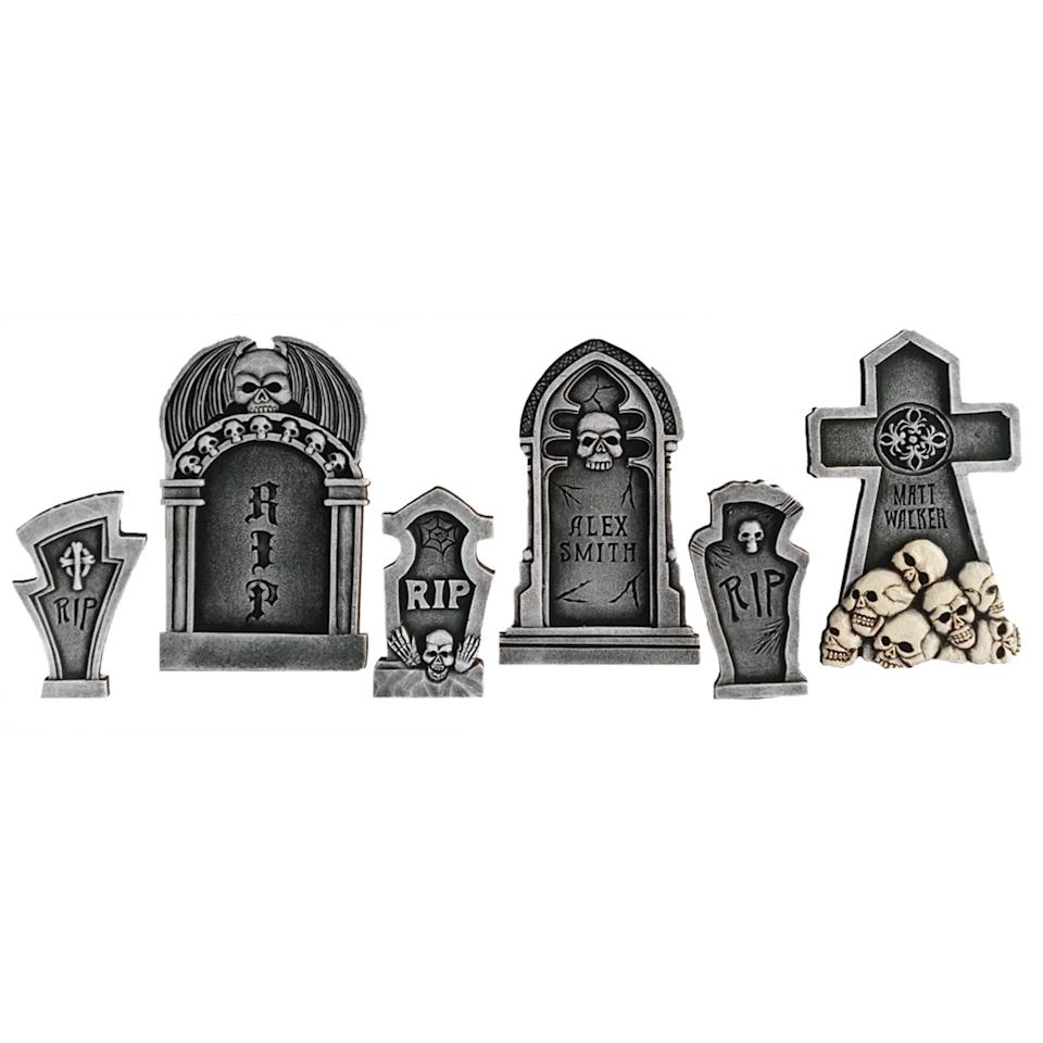 """<p>Put out this <a href=""""https://www.popsugar.com/buy/Skull-Tombstone-Kit-475664?p_name=Skull%20Tombstone%20Kit&retailer=walmart.com&pid=475664&price=26&evar1=moms%3Aus&evar9=46455022&evar98=https%3A%2F%2Fwww.popsugar.com%2Ffamily%2Fphoto-gallery%2F46455022%2Fimage%2F46455123%2FSkull-Tombstone-Kit&list1=shopping%2Challoween%2Cwalmart%2Challoween%20decor&prop13=api&pdata=1"""" rel=""""nofollow"""" data-shoppable-link=""""1"""" target=""""_blank"""" class=""""ga-track"""" data-ga-category=""""Related"""" data-ga-label=""""https://www.walmart.com/ip/6-Piece-Skull-Tombstone-Kit-3-Small-3-Large-Halloween-Holiday-Decoration-Prop/167031541"""" data-ga-action=""""In-Line Links"""">Skull Tombstone Kit </a> ($26, set of six) in your front yard.</p>"""