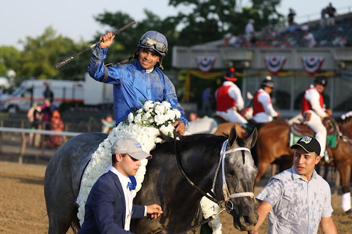 Luis Saez celebrates atop Essential Quality after winning the 153rd running of the Belmont Stakes at Belmont Park on June 05, 2021 in Elmont, New York. / Credit: / Getty Images