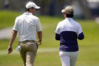 Rory McIlroy, of Northern Ireland, left, walks with U.S. Women's Open golf winner Yuka Saso, of the Philippines, during a practice round of the U.S. Open Golf Championship, Tuesday, June 15, 2021, at Torrey Pines Golf Course in San Diego. (AP Photo/Gregory Bull)