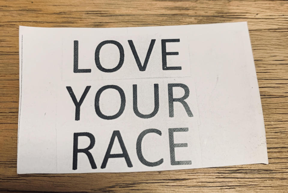 """A sign that read """"LOVE YOUR RACE"""" was posted outside on the store front of a local business called Broomstick Betty. (Credit: Jacqueline Laven)"""