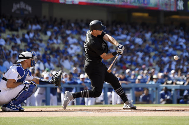 New York Yankees' DJ LeMahieu, right, hits a solo home run as Los Angeles Dodgers catcher Austin Barnes watches during the first inning of a baseball game Sunday, Aug. 25, 2019, in Los Angeles. (AP Photo/Mark J. Terrill)