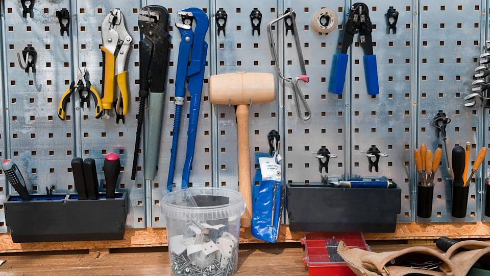 Set of tools on the wall cupboard.