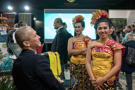 People visit an exhibition of Indonesia inside the venue of the COP24 U.N. Climate Change Conference 2018 in Katowice, Poland, December 6, 2018