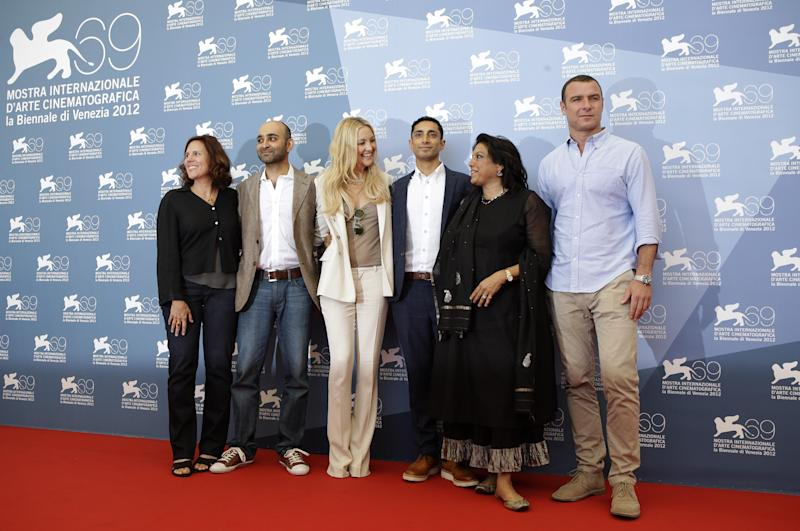 From left, producer Lydia Dean Pilcher, writer Mohsin Hamid, actress Kate Hudson, actor Riz Ahmed, director Mira Nair, and actor Liev Schreiber pose during the photo call for the movie 'The reluctant Fundamentalist' at the 69th edition of the Venice Film Festival in Venice, Italy, Wednesday, Aug. 29, 2012. (AP Photo/Andrew Medichini)