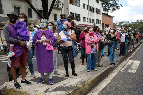 PHOTO: Catholic faithful wearing face masks as they watch the religious procession during Holy Week celebrations in Caracas, Venezuela, March 31, 2021.  (Pedro Rances Mattey/AFP via Getty Images)