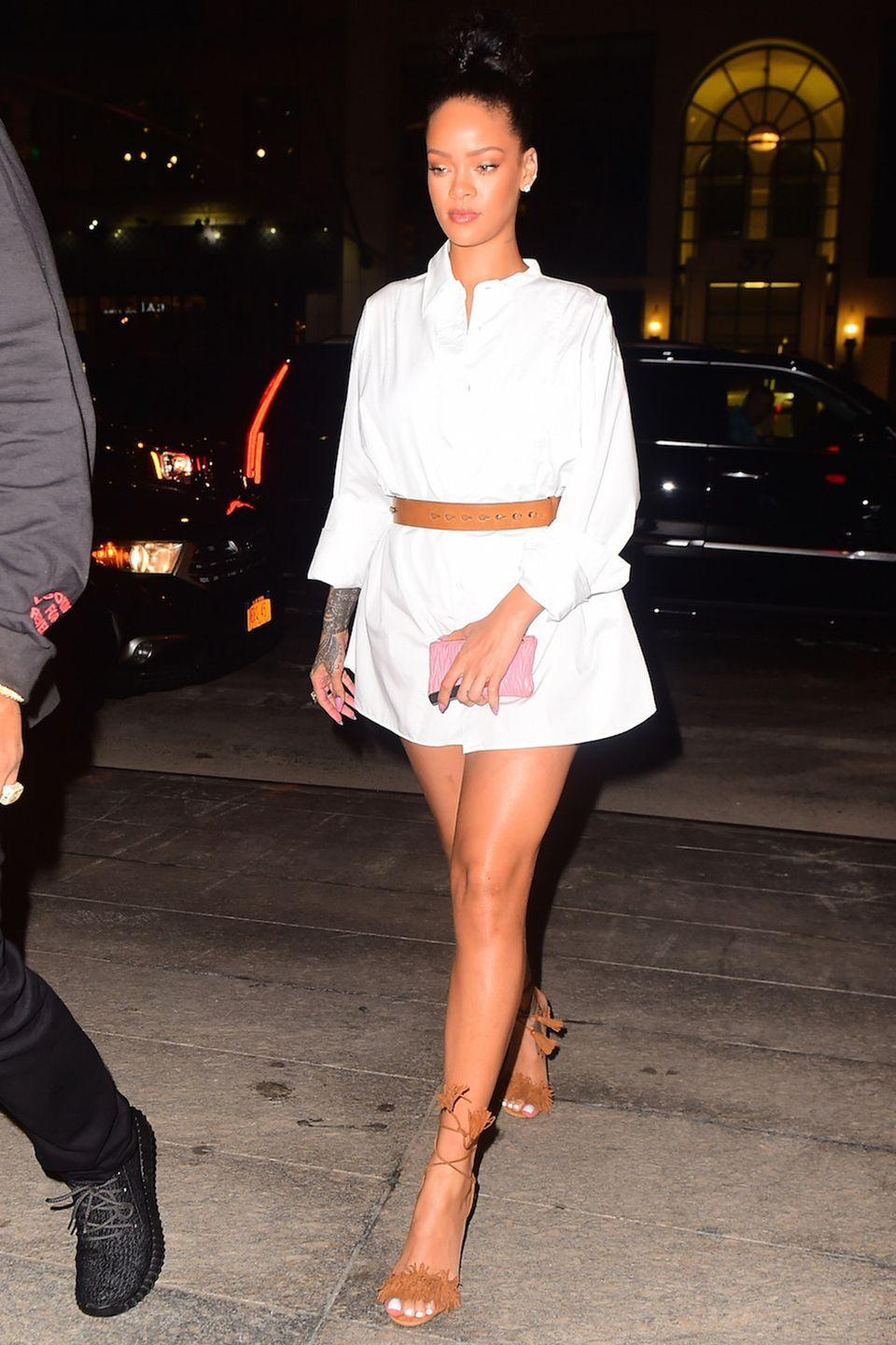 <p>In a white shirtdress, brown belt and matching Aquazzura fringe heeled sandals while out to dinner with Drake at Nobu in NYC.</p>