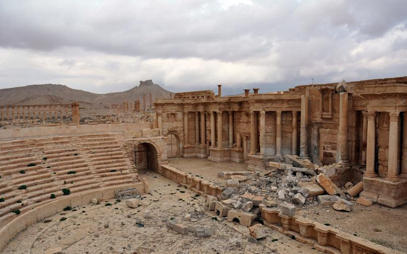 The damaged Roman amphitheatre in the ancient city of Palmyra in central Syria - AFP or licensors