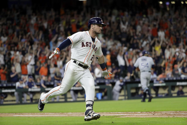 Houston Astros' Alex Bregman (2) celebrates after hitting a game-winning double to score two runs against the Tampa Bay Rays during the ninth inning of a baseball game Monday, June 18, 2018, in Houston. The Astros won 5-4. (AP Photo/David J. Phillip)
