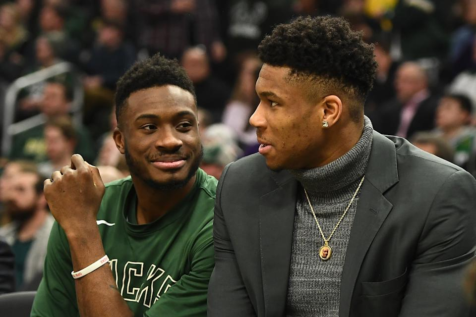 MILWAUKEE, WISCONSIN - DECEMBER 28:  Thanasis Antetokounmpo #43 and Giannis Antetokounmpo #34 of the Milwaukee Bucks watch action from the bench during the first half of a game at Fiserv Forum on December 28, 2019 in Milwaukee, Wisconsin. NOTE TO USER: User expressly acknowledges and agrees that, by downloading and or using this photograph, User is consenting to the terms and conditions of the Getty Images License Agreement. (Photo by Stacy Revere/Getty Images)