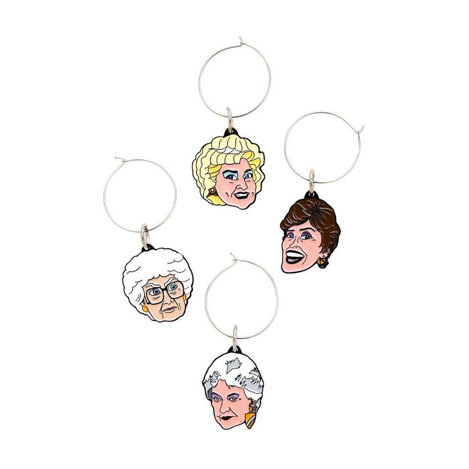 """<p><strong>Just Funky</strong></p><p>target.com</p><p><a href=""""https://www.target.com/p/just-funky-golden-girls-wine-charms-set-of-4/-/A-76170972"""" rel=""""nofollow noopener"""" target=""""_blank"""" data-ylk=""""slk:Shop Now"""" class=""""link rapid-noclick-resp"""">Shop Now</a></p><p>Now when you get together with your best friends, you won't have to worry that someone is drinking your Blanche — ahem, drinking <em>out of </em>your Blanche glass, because you'll have a charm around the stem indicating that it's yours. Plus, they're the cutest accessory to make wine night even more fun.</p>"""