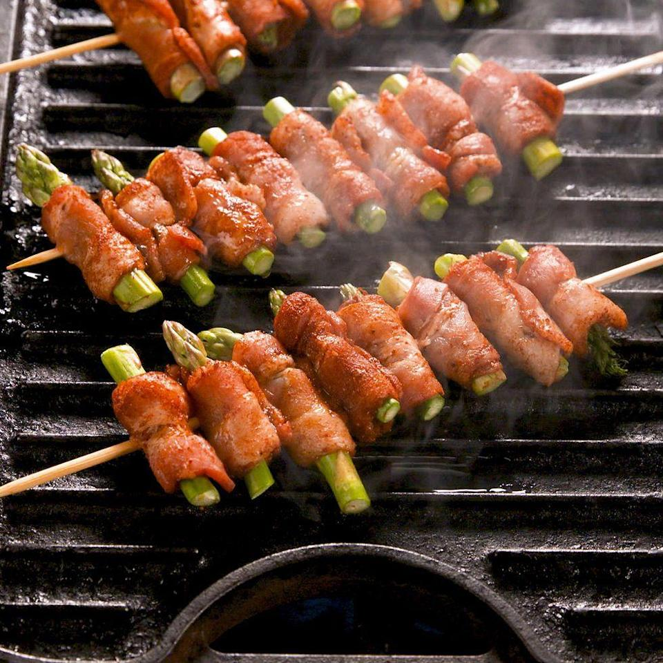 """<p>These bacon-wrapped asparagus skewers will be a hit at your next cookout. Make them before summer ends! </p><p>Get the <a href=""""https://www.delish.com/uk/cooking/recipes/a35359699/bacon-wrapped-asparagus-skewers-recipe/"""" rel=""""nofollow noopener"""" target=""""_blank"""" data-ylk=""""slk:Bacon-Wrapped Asparagus Skewers"""" class=""""link rapid-noclick-resp"""">Bacon-Wrapped Asparagus Skewers</a> recipe.</p>"""