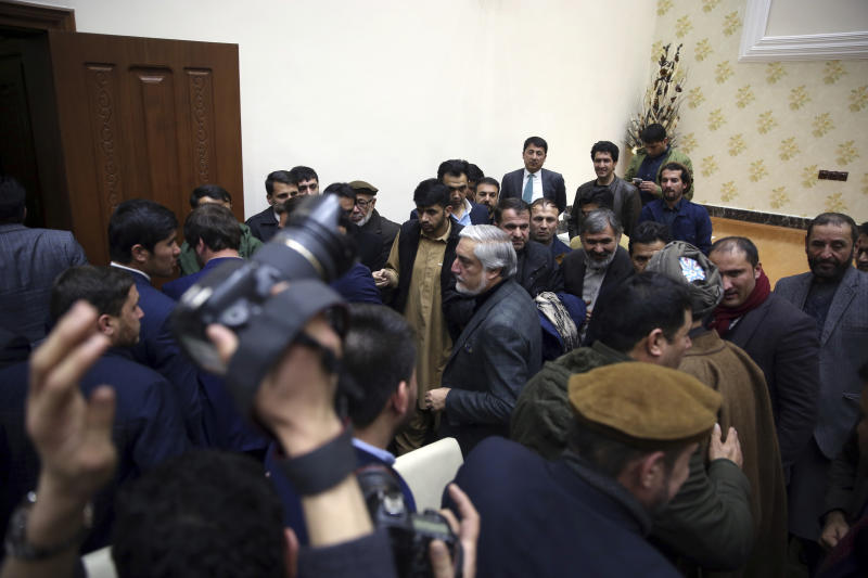 Afghan presidential candidate Abdullah Abdullah, center, leaves after a press conference in Kabul, Afghanistan, Sunday, Dec. 22, 2019. Afghanistan's election commission said the country's incumbent, President Ashraf Ghani, has won a second term in office, according to a preliminary vote count. But his opponents can still challenge the results that were announced on Sunday. (AP Photo/Rahmat Gul)