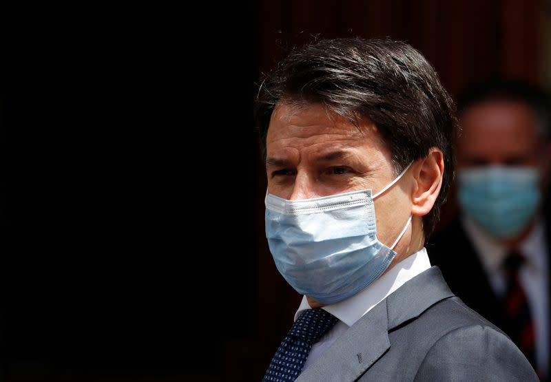 Italian Prime Minister Giuseppe Conte wearing a protective face mask, leaves the Senate as the spread of the coronavirus disease (COVID-19) continues, in Rome