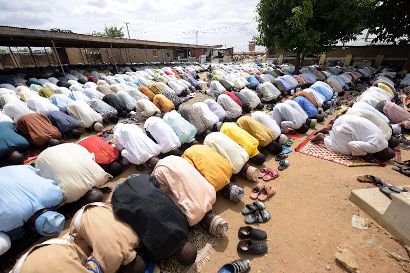 Men pray at Jimeta Central Mosque in Yola, Adamawa state, on June 19, 2015 (AFP Photo/Pius Utomi Ekpei)