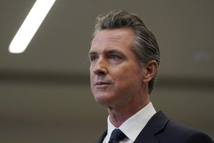 FILE — In the July 26, 2021 file photo Gov. Gavin Newsom speaks at a news conference in Oakland, Calif. Four of the high-profile Republican candidates, who are seeking to replace Newsom in next months recall election, are heading into their first televised debate, to be held Wednesday, Aug. 4, 2021. (AP Photo/Jeff Chiu, File)