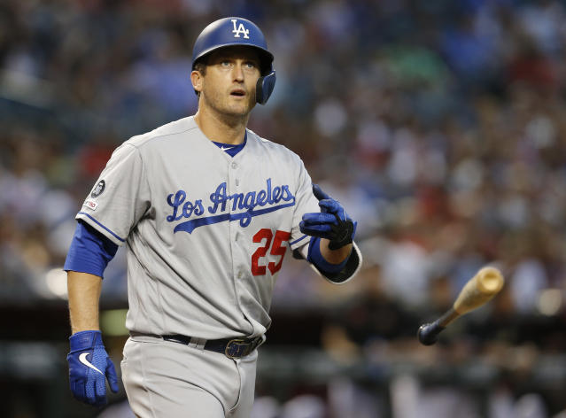 FILE - In this June 3, 2019, file photo, Los Angeles Dodgers third baseman David Freese tosses his bat in the first inning during a baseball game against the Arizona Diamondbacks in Phoenix. David Freese is retiring after a 10-year career that included a World Series title in 2011 with the St. Louis Cardinals when he was MVP. The 36-year-old infielder made the announcement Saturday, Oct. 12, 2019, on his verified Twitter account. (AP Photo/Rick Scuteri, File)