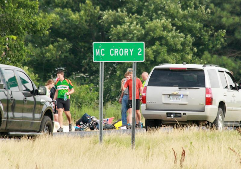This July 2, 2013, photo provided by Walter Breckenridge shows the scene of an accident in McCrory, Ark., after an a car crashed into a group of bicyclists from a Massachusetts-based summer camp program on a cross-country trip, according to authorities. A spokesperson for the program said three cyclists were airlifted to hospitals in Little Rock and Memphis, Tenn., while four other bicyclists were taken to local hospitals. Names have not been released and the car's driver wasn't injured. (AP Photo/Walter Breckenridge) MANDATORY CREDIT