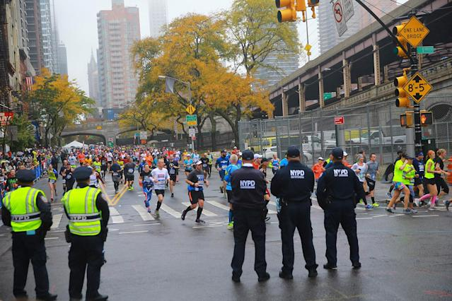 <p>A police presence is seen as runner gives cross into Manhattan during the 2017 New York City Marathon, Nov. 5, 2017. (Photo: Gordon Donovan/Yahoo News) </p>