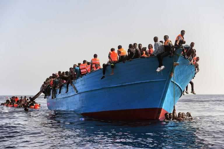 Italy coast guard says at least 20 dead in migrant capsizing