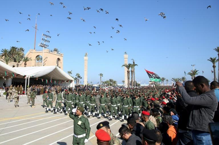 In the Libyan capital Tripoli, under the control of the Turkish-backed Government of National Accord (GNA), soldiers opposed to Haftar marched on Thursday to mark Libya's 69th anniversary of its independence