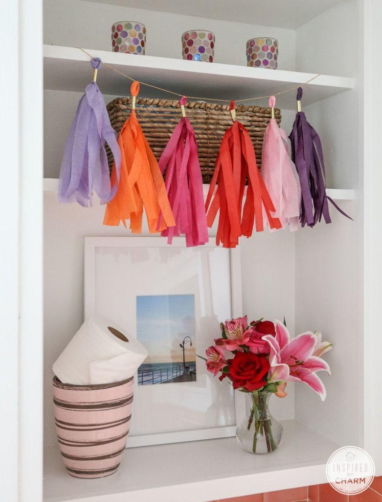 "<p>Take a cue from that very important part of their graduation cap and string together a banner made of tissue paper tassels. Bonus points for using their high school or college colors. </p><p><a href=""https://inspiredbycharm.com/diy-tassel-garland/"" rel=""nofollow noopener"" target=""_blank"" data-ylk=""slk:Get the tutorial."" class=""link rapid-noclick-resp"">Get the tutorial.</a></p><p><a class=""link rapid-noclick-resp"" href=""https://www.amazon.com/Craft-Craze-100-Piece-Wrapping-Assorted/dp/B07V524WJ7/?tag=syn-yahoo-20&ascsubtag=%5Bartid%7C10063.g.36078412%5Bsrc%7Cyahoo-us"" rel=""nofollow noopener"" target=""_blank"" data-ylk=""slk:SHOP TISSUE PAPER"">SHOP TISSUE PAPER</a></p>"