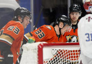 Anaheim Ducks right wing Jakob Silfverberg, center, celebrates after scoring a goal with center Sam Steel, left, and defenseman Ben Hutton in the second period of an NHL hockey game against the Colorado Avalanche, Friday, March 5, 2021, in Denver. (AP Photo/David Zalubowski)